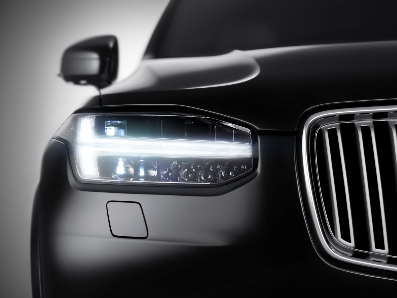 Front view of the all-new XC90, including the distinctive new T-shaped running lights.