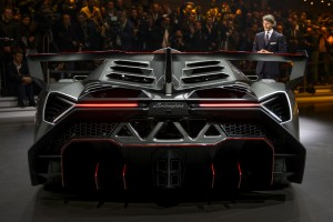 The new Lamborghini Veneno is presented by CEO and Chairman Stephan Winkelmann during a preview of Volkswagen Group on March 4, 2013 ahead of the Geneva Car Show in Geneva. AFP PHOTO / FABRICE COFFRINI (Photo credit should read FABRICE COFFRINI/AFP/Getty Images)